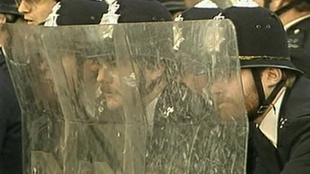 Police behind riot shields
