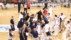 The Bayi and Georgetown University basketball teams brawl during a friendly game at the National Olympic Sports Center Gymnasium in Beijing in August