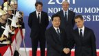 Chinese President Hu Jintao and French President Nicolas Sarkozy in Cannes