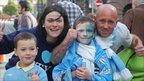 Laura Carroll, 27, from Wythenshawe and Gary Humphreys, 36, from Timperley with their children at the Manchester City homecoming parade