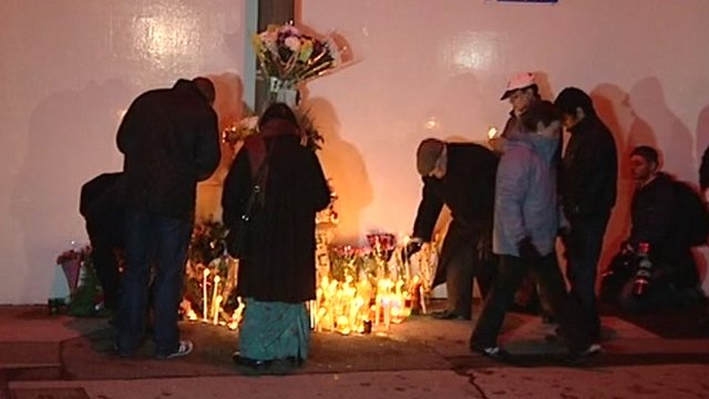 People lighting candles at the spot where Anuj Bidve was killed