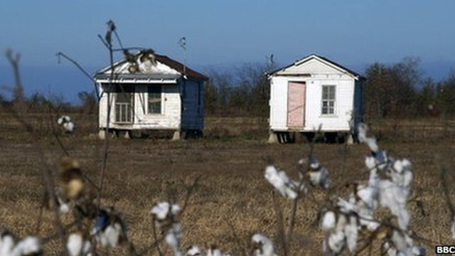 Two sharecropper shacks in a field near Belzoni turned into museum pieces