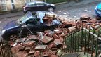 Rubble from chimney stack on car in Partick, Glasgow