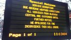Sign about suspended rail services at Glasgow Central Station