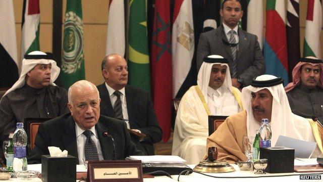 Arab League Secretary-General Nabil Al Araby (L) and Qatari Foreign Minister Hamad bin Jassim