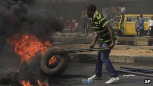 A Protester set fire on a major road in commercial capital during a fuel subsidy protest in Lagos, Nigeria, Tuesday, Jan. 3, 2012.