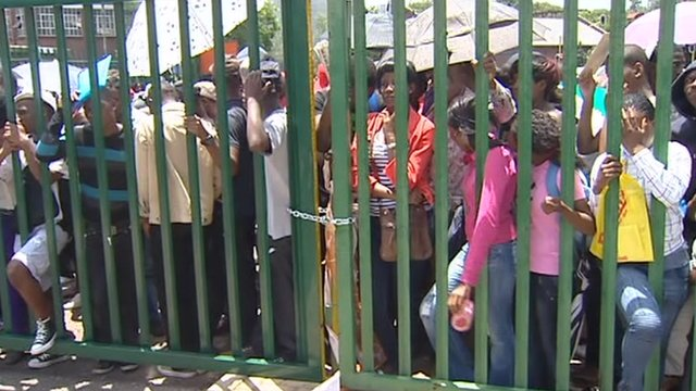Youths behind locked gate