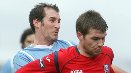 Gary Haveron challenges Coleraine's Stephen Lowry while playing for Ballymena United last season