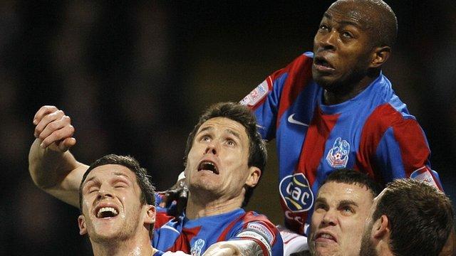 Crystal Palace's Anthony Gardner rises high
