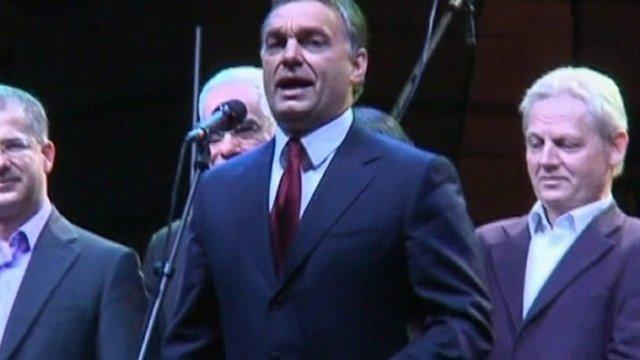 Hungarian Prime Minister, Viktor Orban speaks at a microphone.
