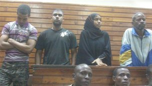The four defendants standing in court in Mombasa, Kenya, 12 January 2012