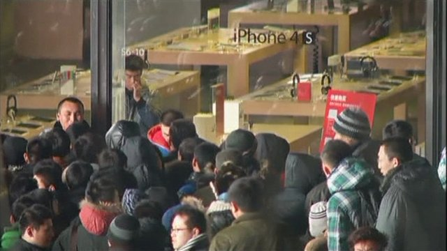 Crowd outside an Apple store in Beijing, where eggs were thrown