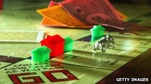 Monopoly game board and money