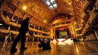 Darren Unsworth polishes the wooden floor during the annual cleaning of the ballroom in Blackpool Tower in Blackpool