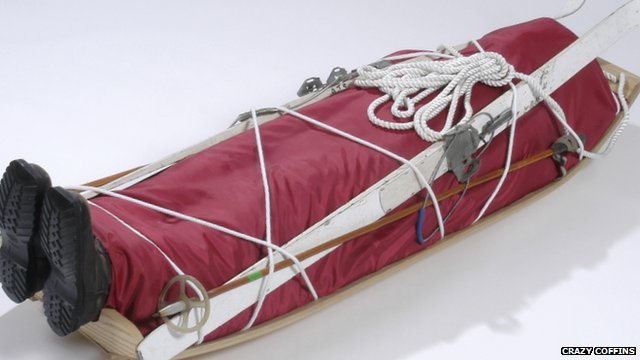 A sledge-shaped coffin complete with skis