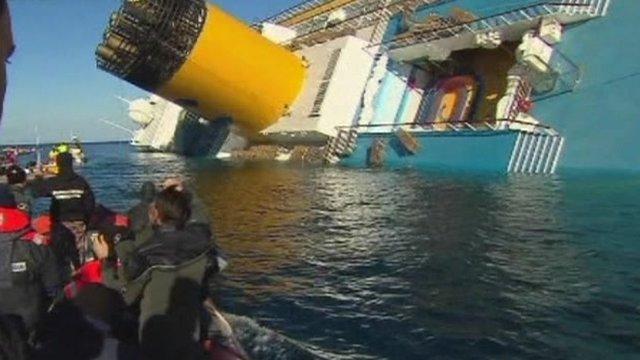 Coastguard boat near sunk cruise ship