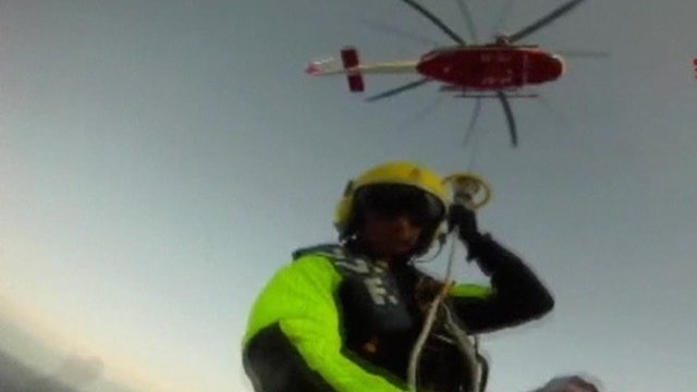 Man lowered from helicopter onto liner