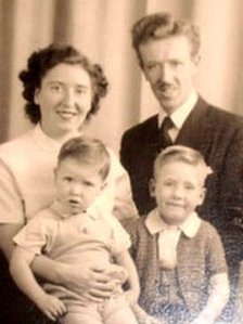 John Kennedy as a baby with his parents and brother