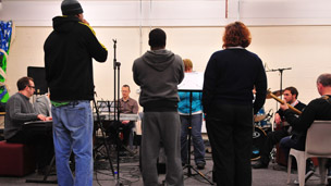 Prisoners, staff and musicians rehearsing Beyond This