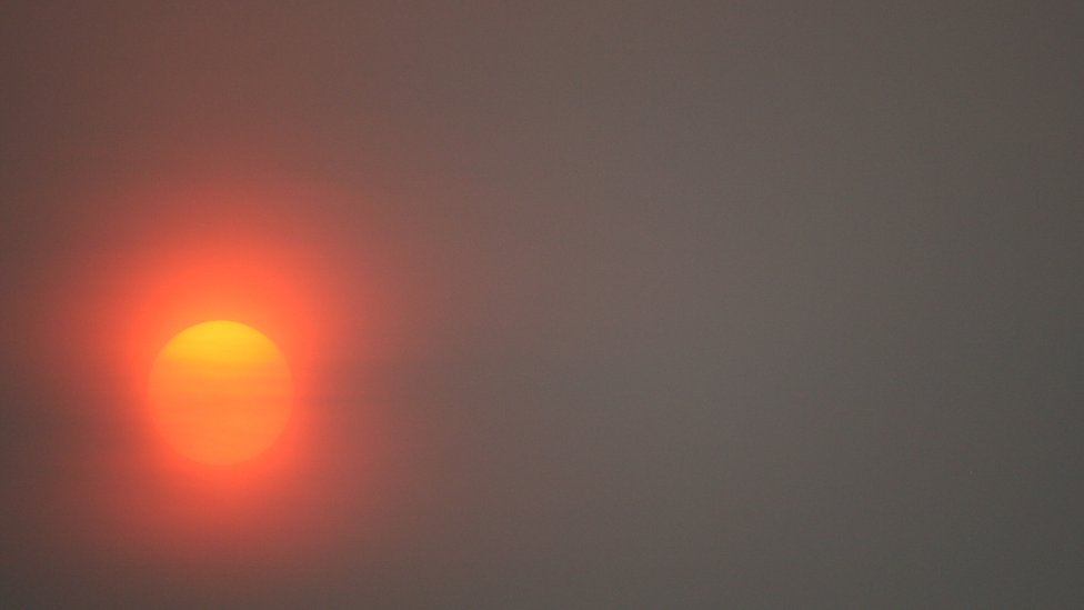 The sun pictured through the haze of smoke