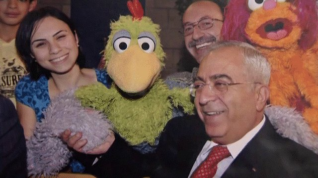 Characters from Sesame Street with Palestinian Authority Prime Minister Salam Fayyad