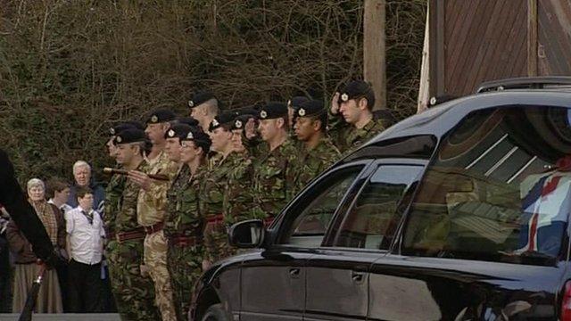 Soldiers saluting cortege