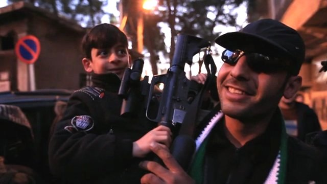 Man carrying a child and gun