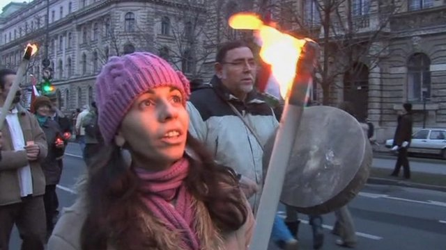 Protestor carries torch in Hungary