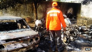 Burnt-out wreckage from bomb attacks in Kano, Nigeria, on 22 January 2012