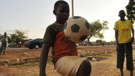 Children play football in the streets of Harovanda, a lower class neighborhood of Niamey, on September 11, 2012.