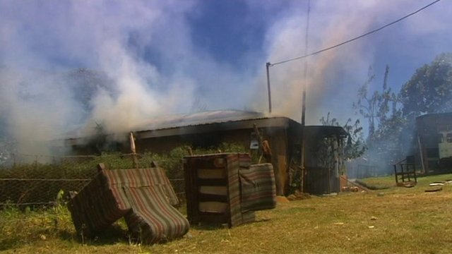 Kenyan home on fire in post election violence in 2007