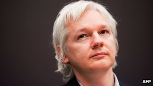 Julian Assange attends a press conference in London, 1 December