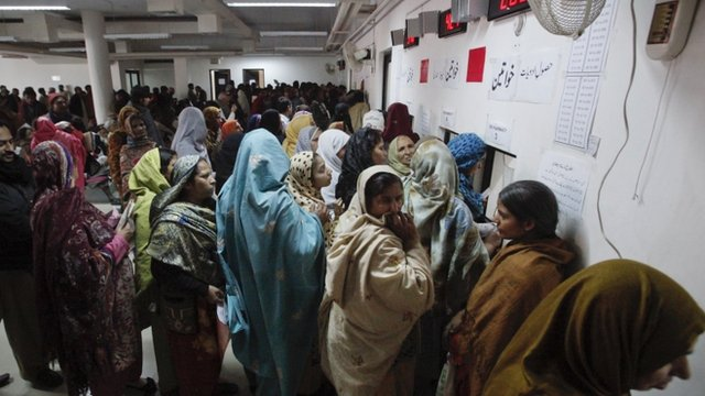Women stand in queue to receive free medication in Pakistan