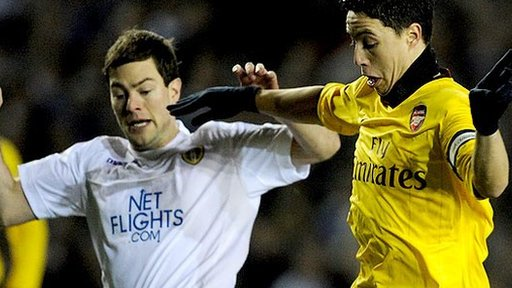 Ben Parker (left) tussles with then Arsenal midfielder Samir Nasri during last season's FA Cup
