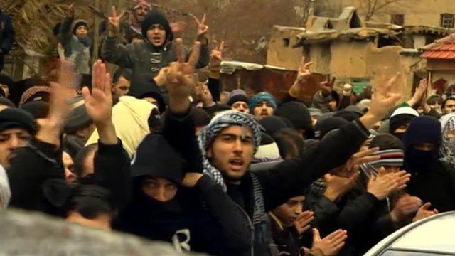 Anti-Assad demonstrators in the Damascus suburb of Saqba