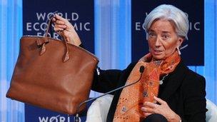 Christine Lagarde and her handbag