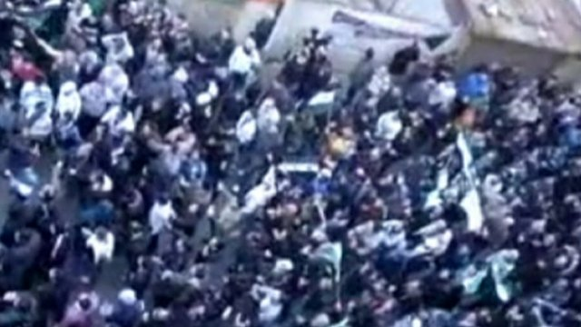 Anti-government protesters in the Syrian city of Homs on Saturday.