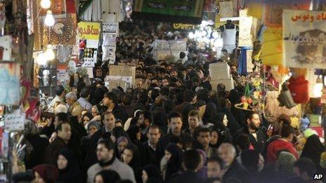Iranians walk through the main old Bazaar of Tehran (26 January 2012)
