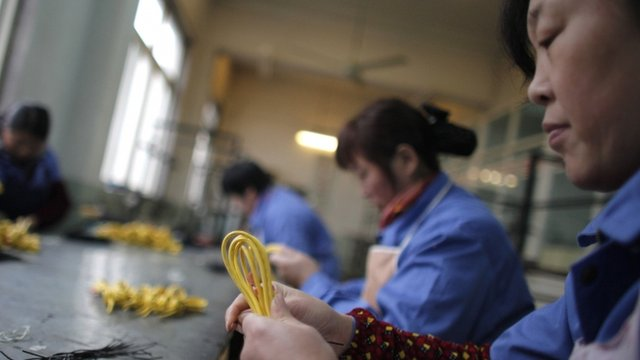 Migrant workers at a factory in China