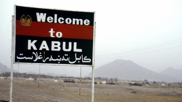 "Sign which says ""Welcome to Kabul""."