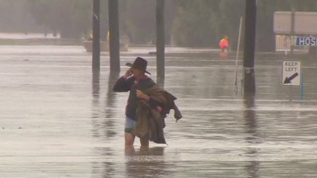 Man standing in floodwater