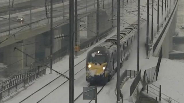 Train drives through the snow