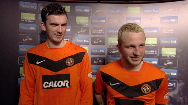 Dundee United's Gavin Gunning (left) and Johnny Russell