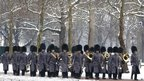 Soldiers march through snow along The Mall in London on Sunday.