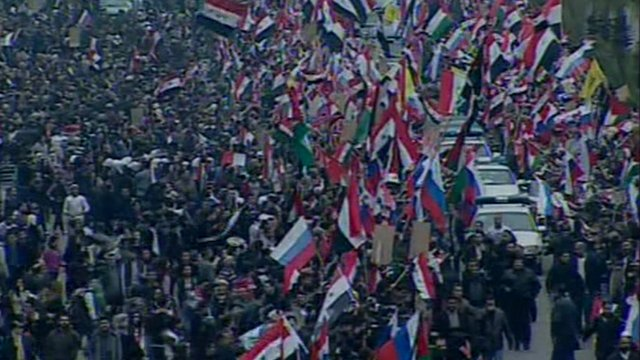 Crowds waving flags in Damascus