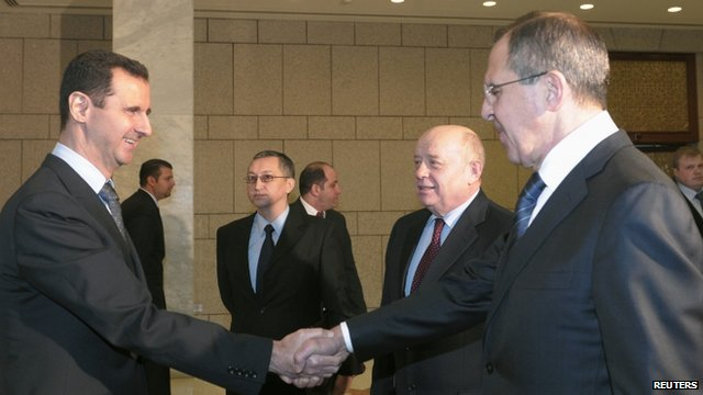 Syrian President Bashar al-Assad (L), shakes hands with Russian Foreign Minister Sergey Lavrov