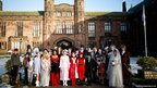 Pupils dressed up as Dickens characters in front of Bolton School