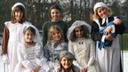 Girls dressed as Dickens characters at Bolton School