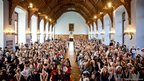 Pupils dressed up as Dickens characters in the Great Hall at Bolton School