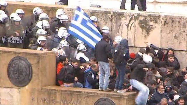 Police and protesters clash in Athens